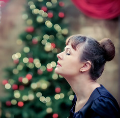 profile of a woman near  Christmas tree