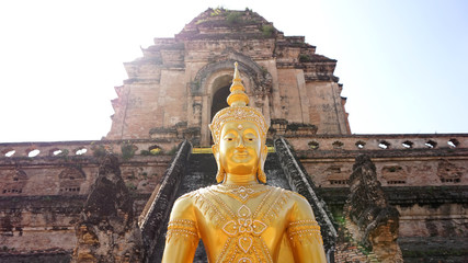 golden buddha in front of ruins temple, Thailand
