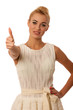 Beautiful young woman gesturing success with thumb up isolated o