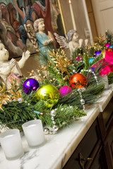 Christmas Ornaments on a Marble Mantle