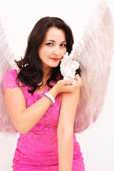 Christmas angel women with a gift, smiling seductively