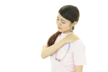 疲れた様子の看護師