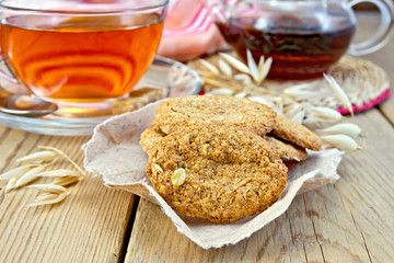 Cookies oatmeal with spikelet and napkin on board