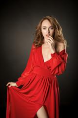 Girls in erotic red dress posing