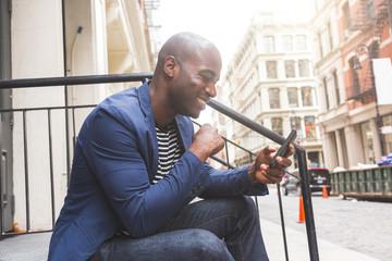 Black Guy Using Smart Phone