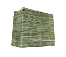 Pile of paper currency isolated on white background