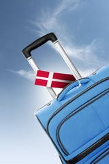 Destination Denmark. Blue suitcase with flag.