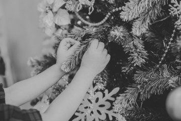 child decorate a Christmas tree