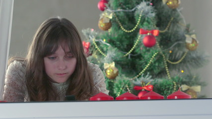 Girl typing greeting text message for Christmas by phone
