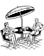 Couple Sitting On Patio