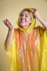 Woman wearing a yellow Poncho in wet weather