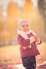 Beautiful outdoor autumn portrait of adorable toddler girl