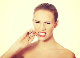 Beautiful woman with raw garlic in mouth.