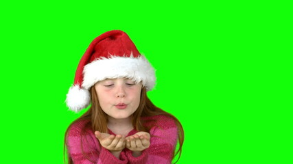 Festive girl blowing in slow motion