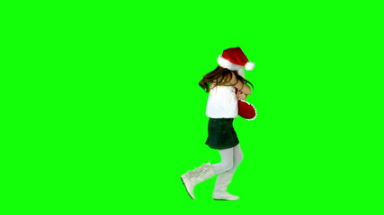 Little girl hugging stocking in slow motion