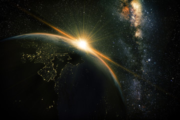 unrise view of earth from space with milky way galaxy