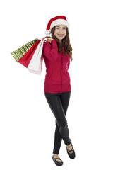Christmas Santa woman with paper shopping bags