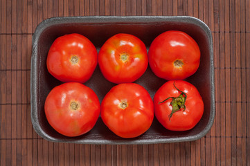 Packed tomatoes.