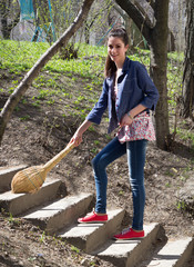 Girl sweeps with a sweeper