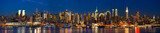 Manhattan skyline panorama at night, New York poster