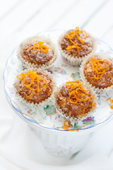 carrot-orange muffins on a white background