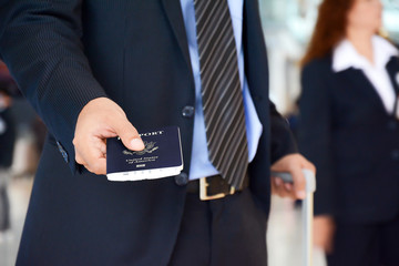 Businessman giving U.S. passport - check in & boarding concepts