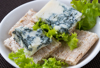 Sliced roquefort cheese on the  toasted bread