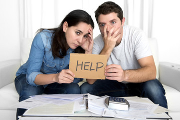 young couple worried at home in bad financial situation stress