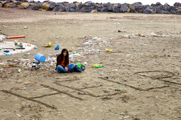 Woman desperate about dirt and pollution on the beach
