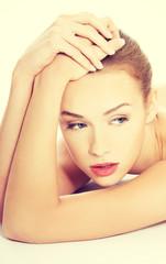 Beautiful naked topless caucasian woman lying down.