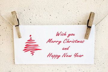 Clothespins holding christmas greeting card