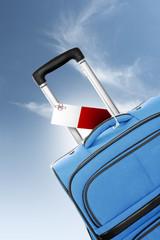 Destination Malta. Blue suitcase with flag.