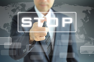 Businessman hand pointing to STOP sign on virtual screen