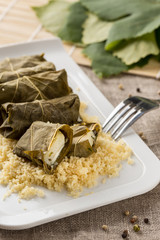 fish fillet in grape leafs with couscous. Dolma