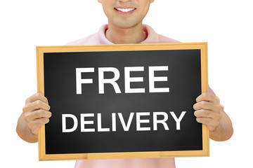 Free delivery sign on blackboard held by smiling man