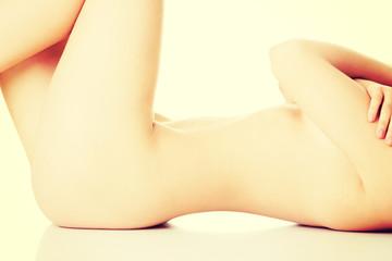 Female naked body lying on the floor.