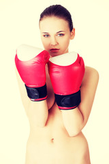 Attractive naked woman with boxing gloves.