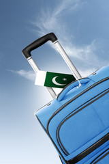 Destination Pakistan. Blue suitcase with flag.