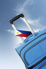 Destination Philippines. Blue suitcase with flag.