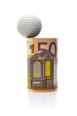 EURO SUCCEEDING-A golf ball ready to score in a euro-made hole.