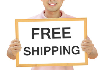 Free shipping sign on whiteboard held by smiling man
