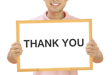 THANK YOU words on whiteboard held by smiling man