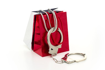 FASHION VICTIM-Two shopping bags got 'arrested' with handcuffs.