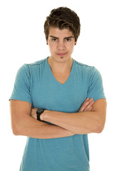 man in a blue shirt looking with arms folded
