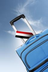 Destination Yemen. Blue suitcase with flag.