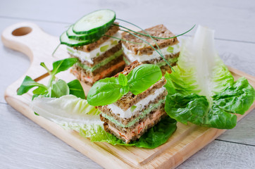 Rye granary bread sandwich with curd and salad leaves