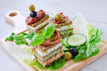 Rye granary bread sandwich with curd and antipasto