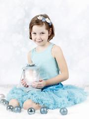 Pretty little girl with lantern