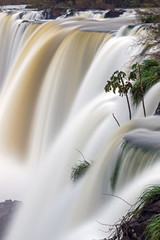 Detail of the Iguazu waterfall in Argentina with blurred motion