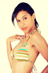 Portrait of dark skinned girl in bikini